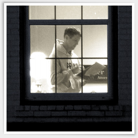 At night, Walter McKee is seen through a window with a light on, reading notes from his pad of paper.